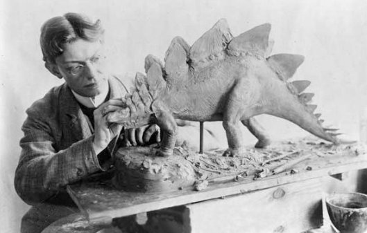 The artist with a model of a stegosaur, 1899.